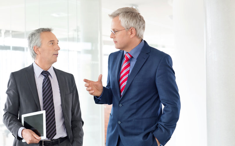 stock-photo-61369856-mature-business-men-discussing-work-in-office